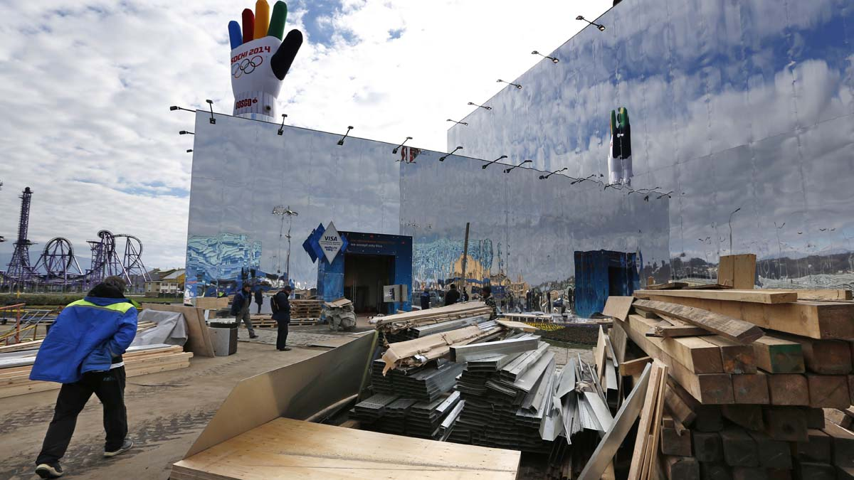 Last-minute work continues in construction of  the Olympic Superstore in Olympic Park, ahead of the 2014 Winter Olympics, Wednesday, Feb. 5, 2014, in Sochi, Russia.