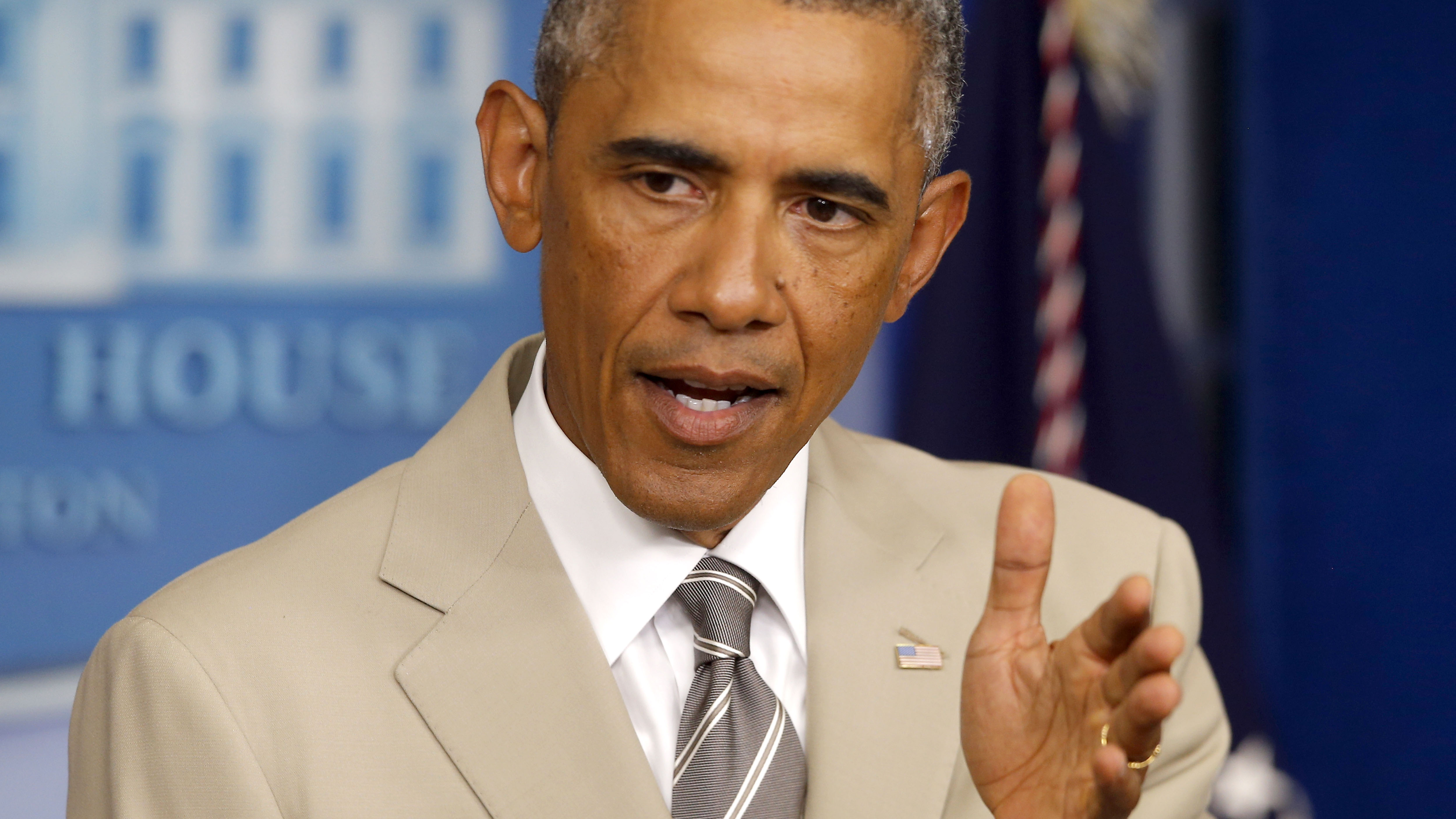 President Barack Obama in his tan suit at a press conference Thursday.