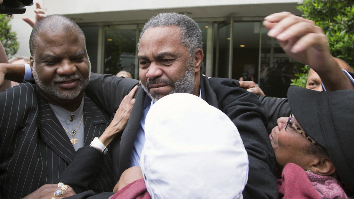 This April 3, 2015, file photo shows Anthony Ray Hinton, center, leave the Jefferson County jail in Birmingham, Alabama. Hinton spent nearly 30 years on Alabama's death row, and was set free after prosecutors told a judge they won't re-try him for the 1985 slayings of two fast-food managers.