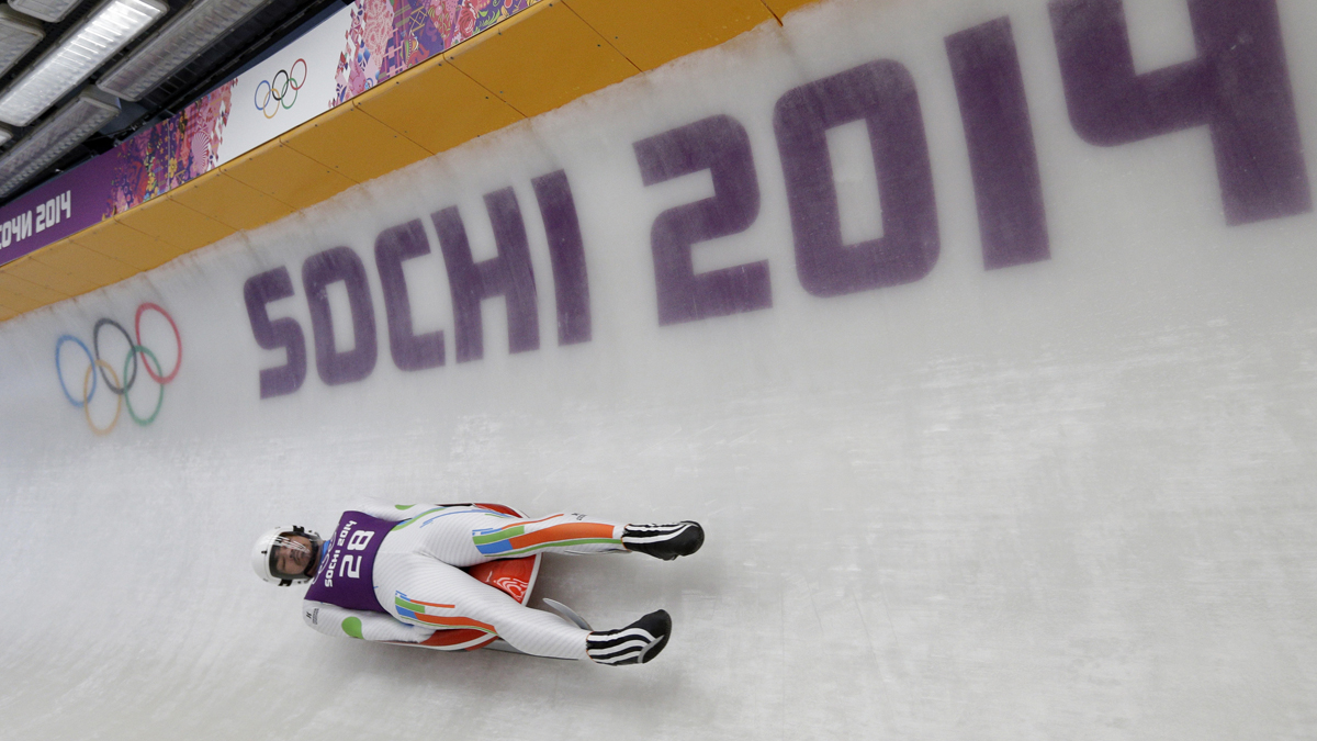 Shiva Keshavan, who if from India but is competing under the Olympics flag, takes a turn during a training session for the men's singles luge at the 2014 Winter Olympics, Thursday, Feb. 6, 2014, in Krasnaya Polyana, Russia. (AP Photo/Michael Sohn)
