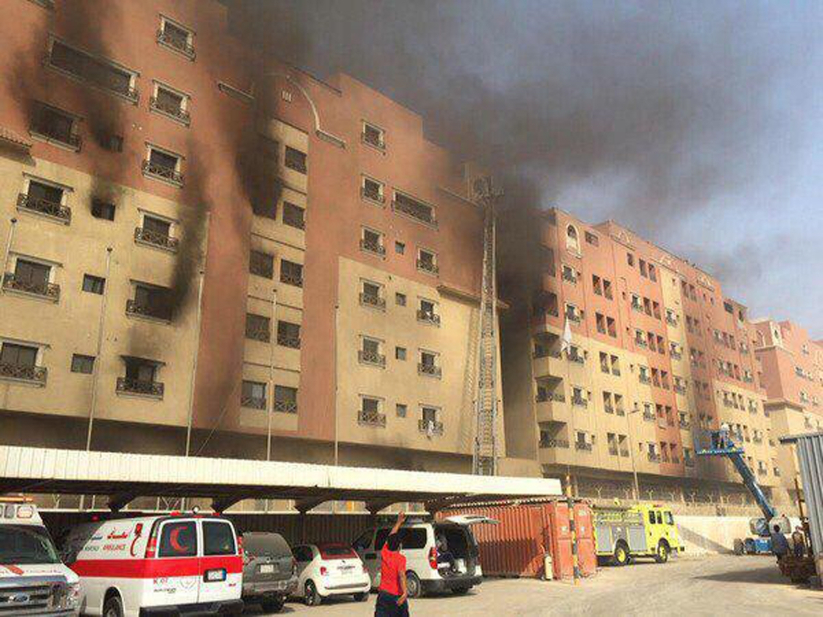 In this image released by the Saudi Interior Ministry's General Directorate of Civil Defense, smoke billows from a residential complex in Khobar, Saudi Arabia, Sunday, Aug. 30, 2015. A fire broke out at the residential complex used by the state oil giant Saudi Aramco. (Saudi Interior Ministry General Directorate of Civil Defense via AP)