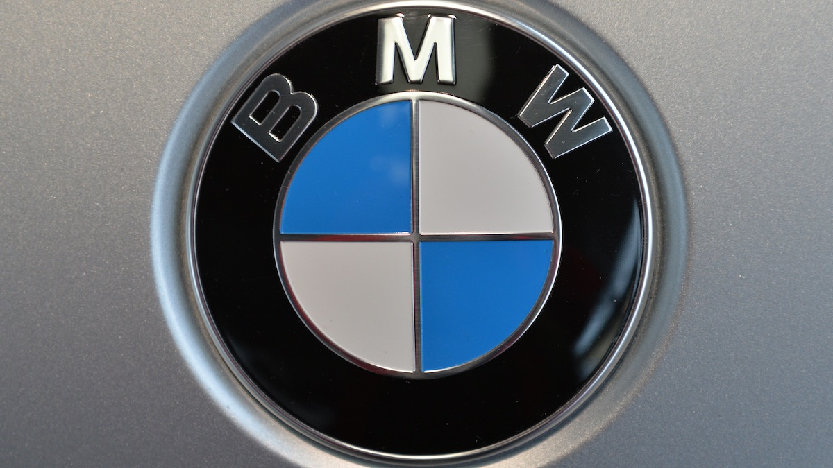 This March 19, 2014, file photo shows the company logo of car manufacturer BMW during the annual balance press conference in Munich, Germany.