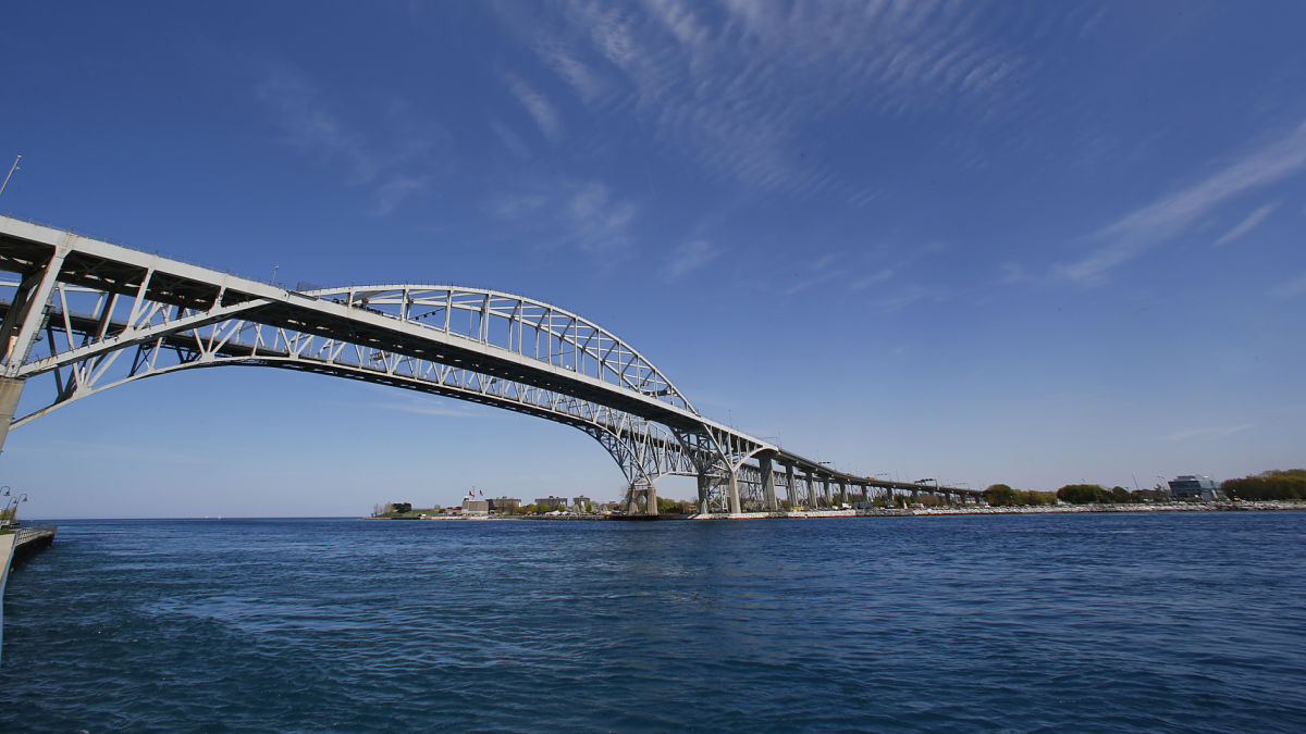 The Blue Water Bridge connecting Sarnia, Ontario to Port Huron, Mich., is shown Friday, May 15, 2015. Coast Guard and police in Sarnia rescued 1,500 people rafting down the St. Clair River, which separates the U.S. from Canada.