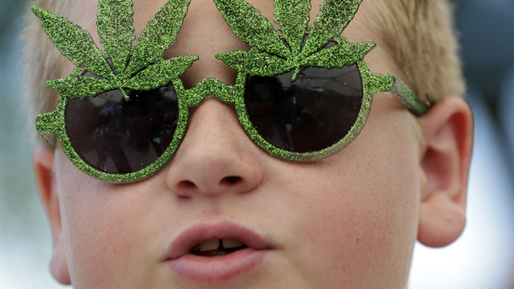 Tommy Gibbons, 14, sports marijuana-themed sunglasses at the first day of Hempfest, Friday, Aug. 16, 2013, in Seattle. Thousands packed the Seattle waterfront park for the opening of a three-day marijuana festival an event that is part party, part protest and part victory celebration after the legalization of pot in Washington and Colorado last fall. Hempfest was expected to draw as many as 85,000 people per day. Click through to see more on the Hempfest fun.