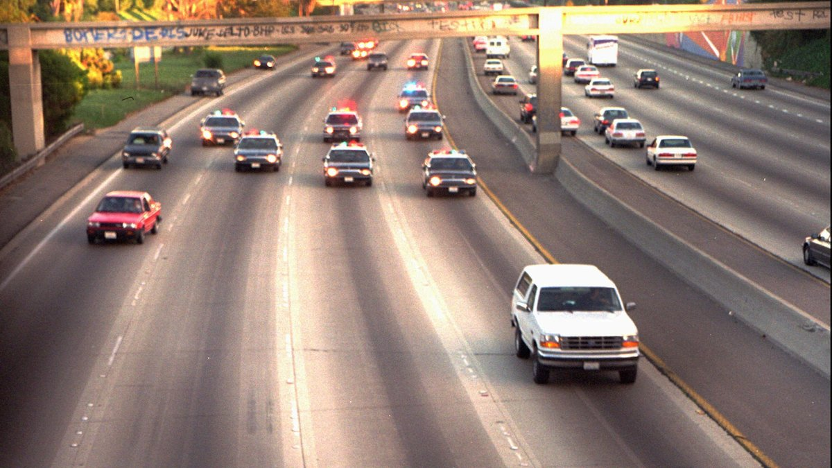 FILE- A white Ford Bronco, driven by Al Cowlings and carrying O.J. Simpson, is trailed by police cars as it travels on a southern California freeway on June 17, 1994, in Los Angeles.  Cowlings and Simpson led authorities on a chase after Simpson was charged with two counts of murder in the deaths of his ex-wife and her friend.  (AP Photo/Joseph Villarin)