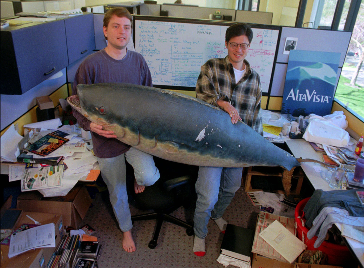 In this March 3, 1997 photo, Yahoo! co-founders David Filo, left, and Jerry Yang hold up a fish prop in Filo's office in Santa Clara, Calif.