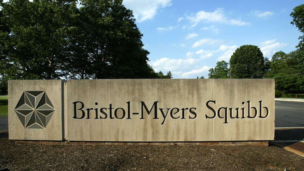 In this file photo, a sign stands in front of the Bristol-Myers Squibb Company's headquarters in a Lawrence Township, N.J. on June 15, 2005.