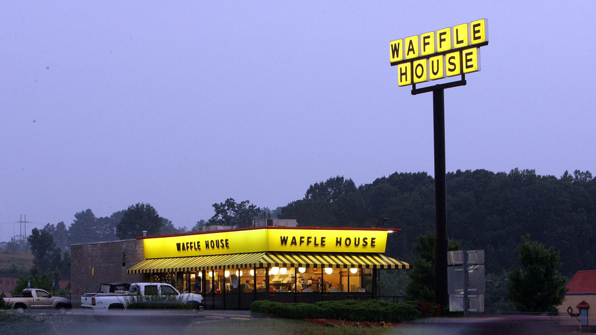 File photo: Traffic flashes by breakfast diners a a Waffle House near Dawsonville, Georgia, Thursday, July 28, 2005.