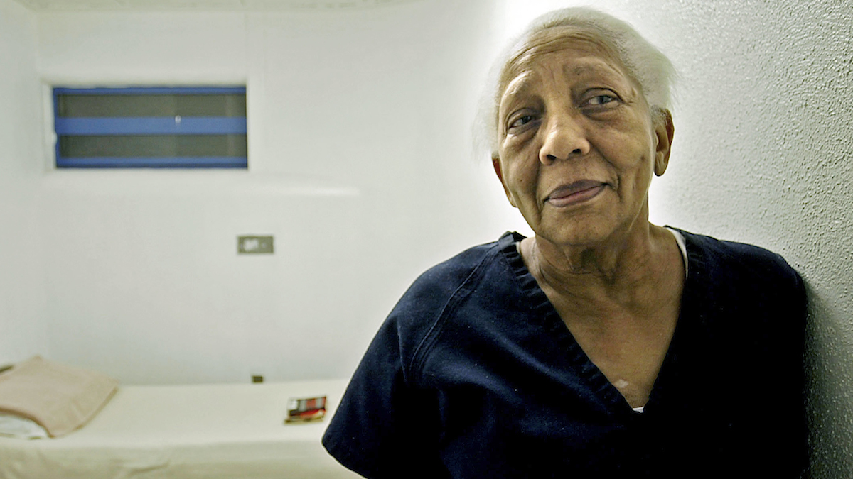 In this Sept. 23, 2005, file photo, Doris Payne, an international jewel thief, poses in her cell at Clark County jail in Las Vegas.
