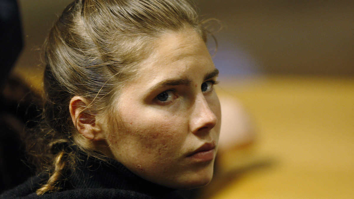 In this file photo, U.S. murder suspect Amanda Knox reacts during a defence hearing by her lawyer Carlo Dalla Vedova at the court in Perugia, Italy, Tuesday, Dec.1, 2009.