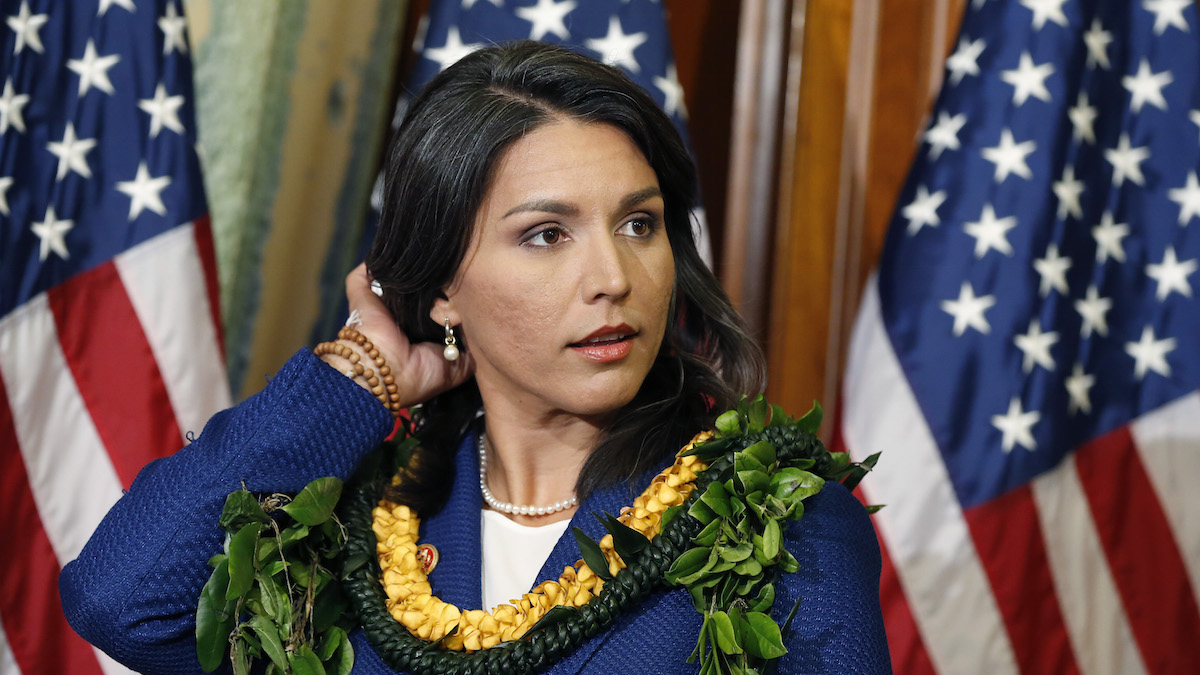 FILE - This Jan. 3, 2013 file photo shows Rep. Tulsi Gabbard, D-Hawaii, waiting for a photo with House Speaker John Boehner, of Ohio, on Capitol Hill in Washington. Gabbard is the first Hindu elected to Congress.