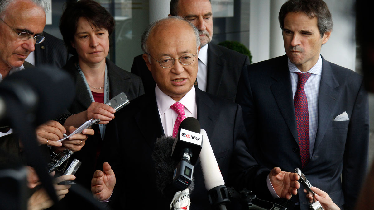 Director General of the International Atomic Energy Agency, IAEA, Yukiya Amano, center, from Japan speaks to the media after returning from Iran at the Vienna International Airport near Schwechat, Austria, on Tuesday, May 22, 2012. Amano says he has reached a deal with Iran on probing suspected work on nuclear weapons and adds that the agreement will