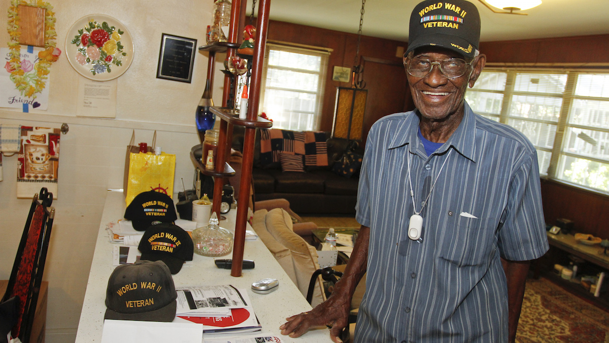 Richard Overton relaxes in his home after being presented with the Philips Lifeline with AutoAlert service on Wednesday, June 5, 2013 in Austin, Texas. Overton served for the Army in the Pacific during World War II.