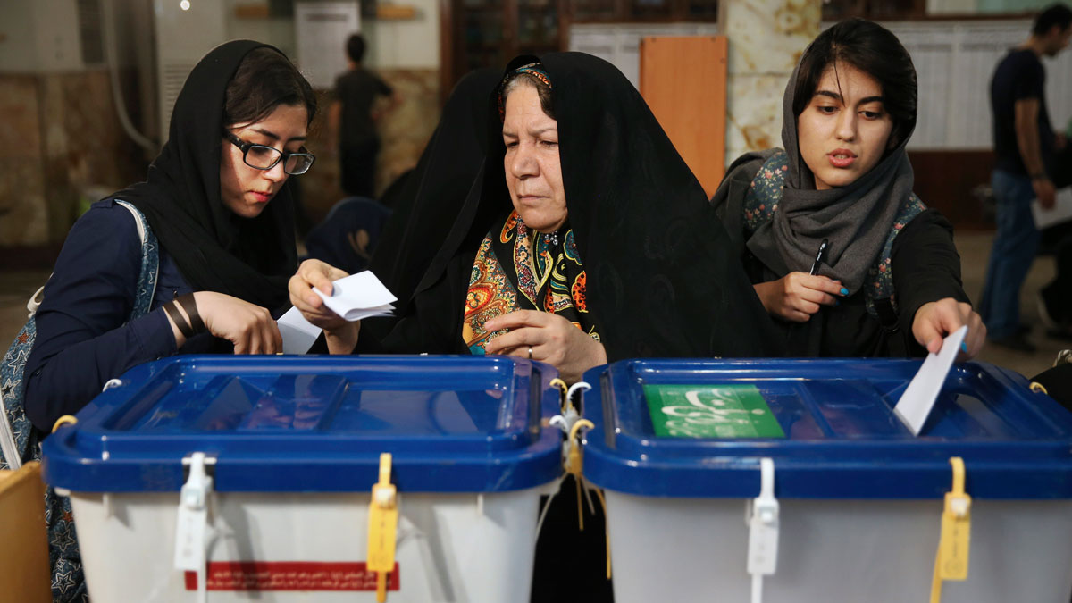Iranian voters cast their ballots during the parliamentary and Experts Assembly elections in a polling station in Tehran, Iran, Friday, Feb. 26, 2016.