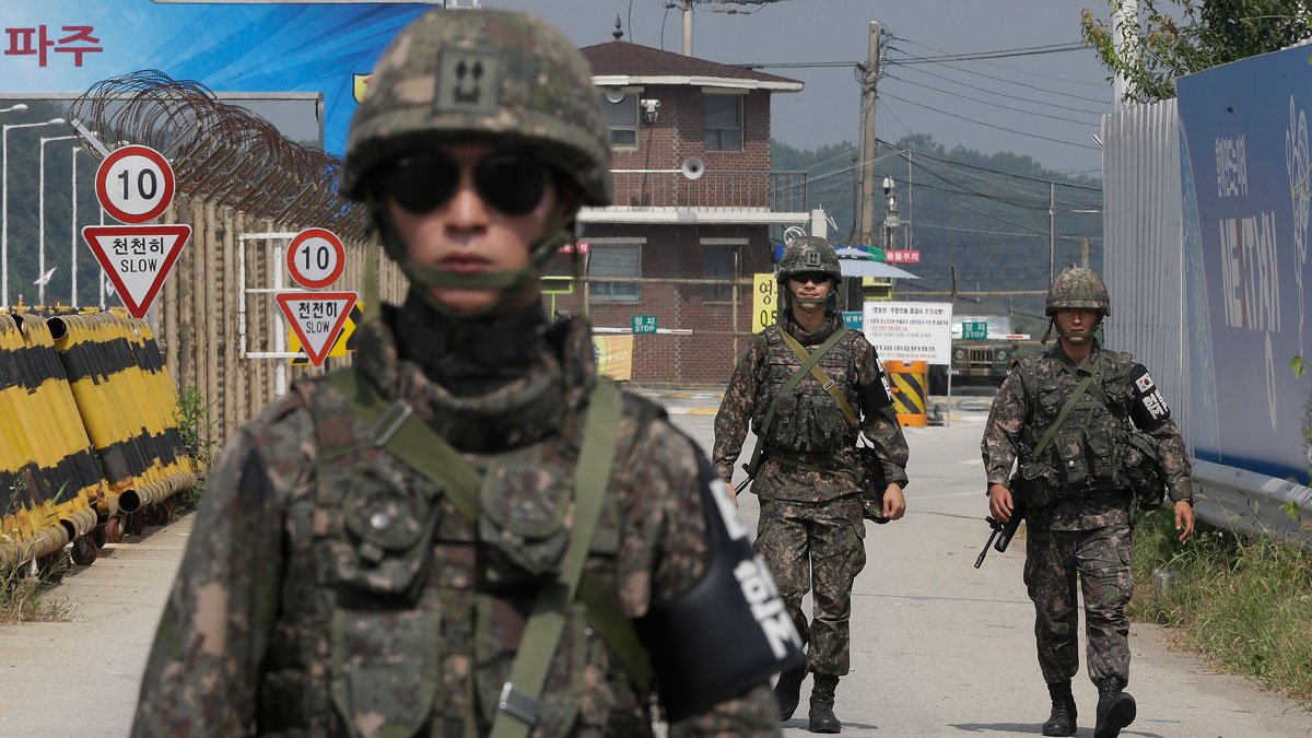 South Korean amy soldiers walk on Unification Bridge, which leads to the demilitarized zone, near the border village of Panmunjom in Paju, South Korea, Sunday, Aug. 23, 2015. South Korean and North Korean officials have resumed the second round of their high-level talks in the border village of Panmunjom on Sunday afternoon in an effort to ease mutual tension, South Korea's presidential office said.