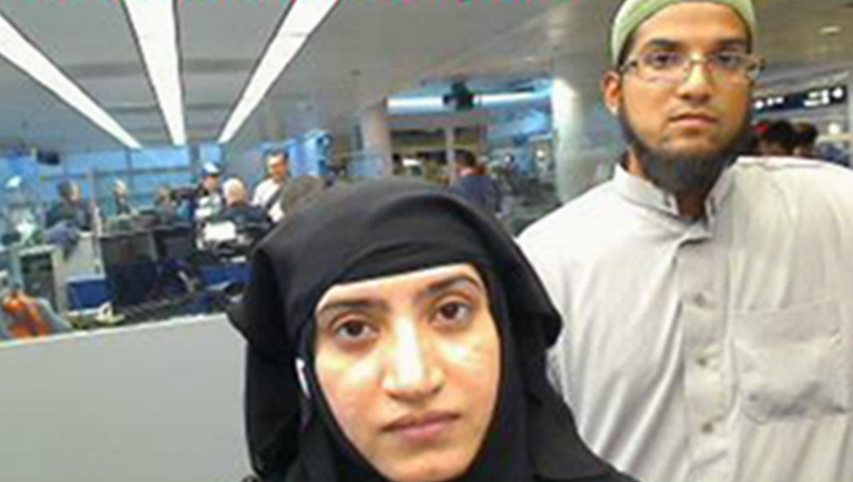 In this July 27, 2014 file photo provided by U.S. Customs and Border Protection shows Tashfeen Malik, left, and Syed Farook, as they passed through O'Hare International Airport in Chicago. The husband and wife died on Dec. 2, 2015, in a gun battle with authorities several hours after their assault on a gathering of Farook's colleagues in San Bernardino, Calif.