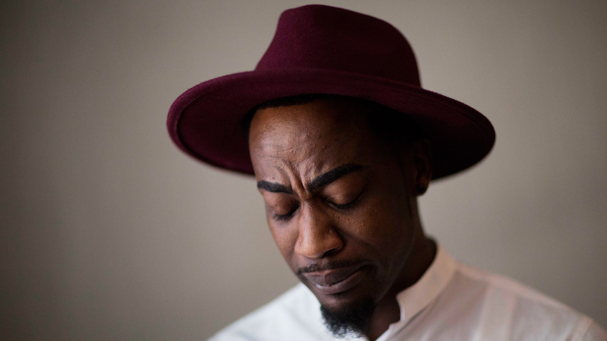 Demetrice Naulings pauses while recalling how he survived the mass shooting at the Pulse nightclub that claimed the life of his friend Eddie Justice, June 14, 2016, in Orlando, Florida.