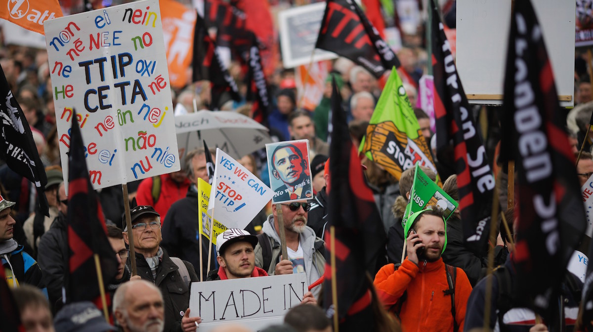Thousands of demonstrators protest against the planned Transatlantic Trade and Investment Partnership, TTIP, and the Comprehensive Economic and Trade Agreement, CETA, ahead of the visit of U.S. President Barack Obama in Hannover, Germany, Saturday, April 23, 2016.
