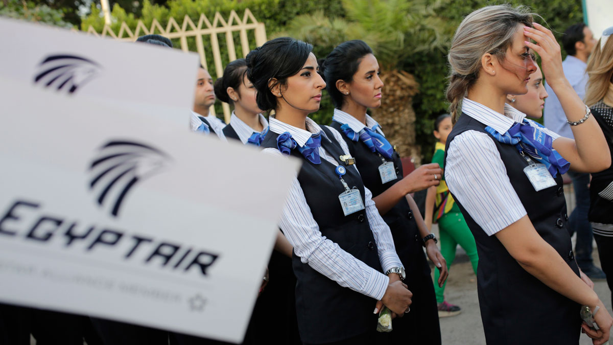 EgyptAir hostesses line up during a candlelight vigil for the victims of EgyptAir flight 804 in Cairo, Egypt, Thursday, May 26, 2016.
