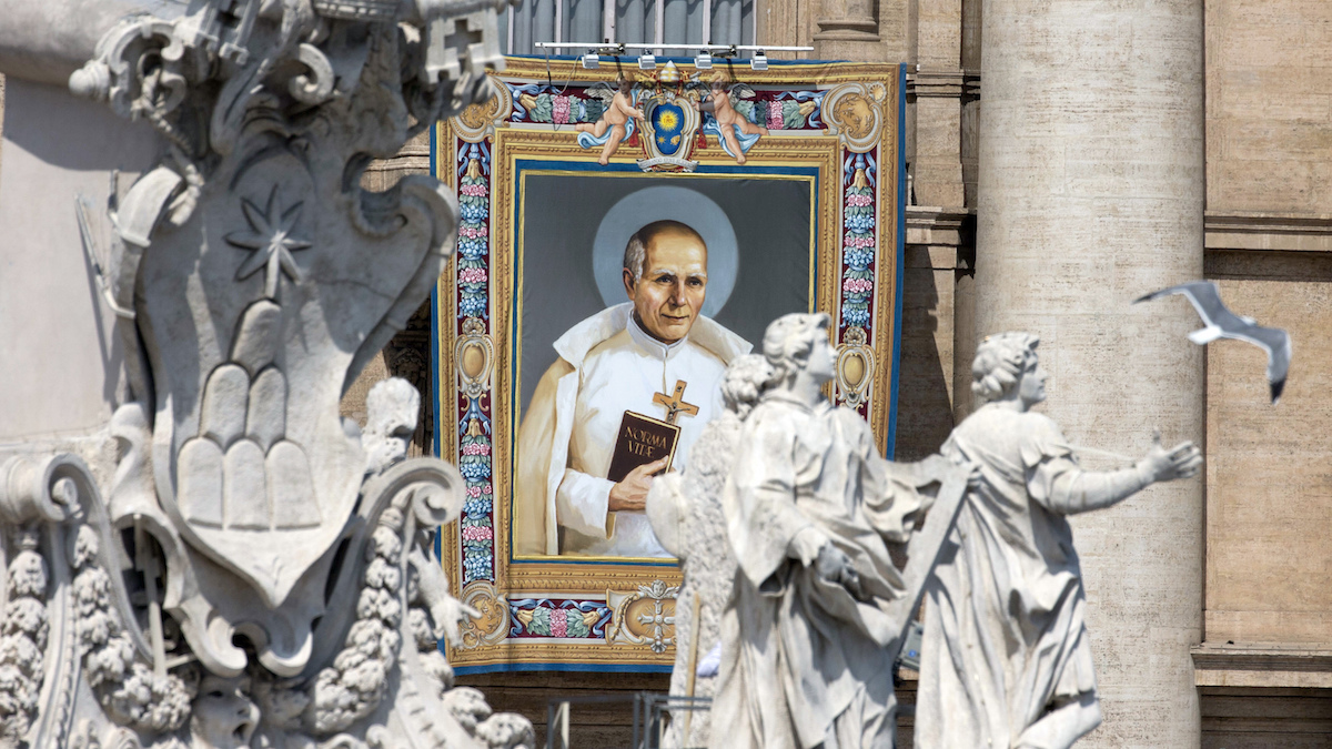 The tapestry of Stanislaus of Jesus and Mary Papczynski, hangs from a balcony in St. Peter's Square at the Vatican during the canonization ceremony led by Pope Francis, on June 5, 2016. Pope Francis has canonized Elizabeth Hesselblad, a Lutheran convert who hid Jews during World War II and Stanislaus, the founder of the first men's religious order dedicated to the immaculate conception.
