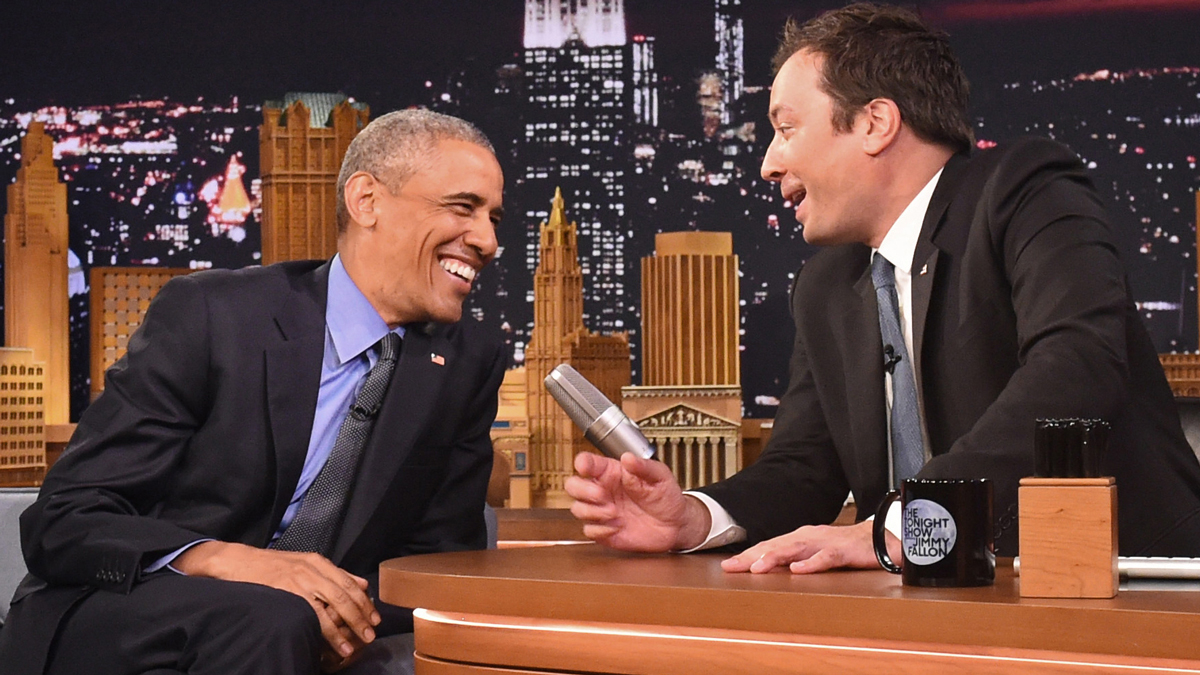 President Barack Obama, left, shares a laugh with host Jimmy Fallon on the set of the