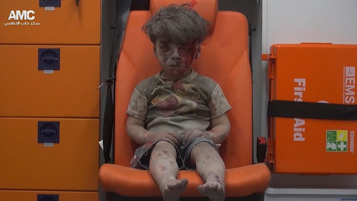 In this frame grab taken from video provided by the Syrian anti-government activist group Aleppo Media Center (AMC), a child sits in an ambulance after being pulled out or a building hit by an airstirke, in Aleppo, Syria, on Aug. 17, 2016. S