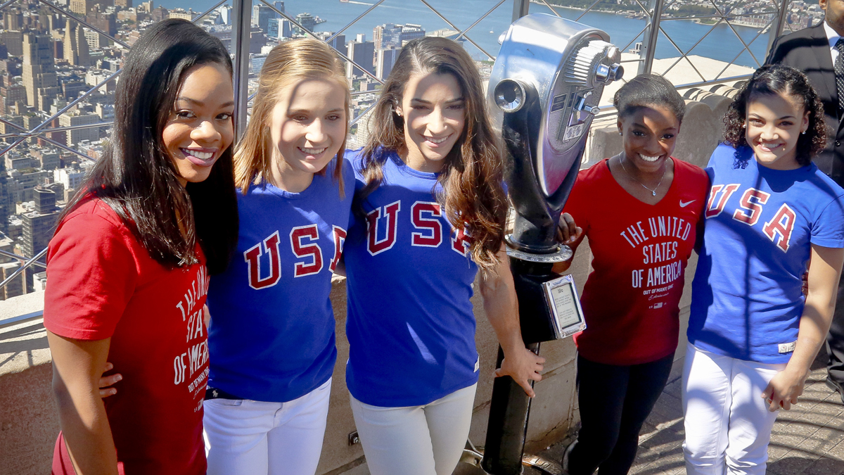 The gold medal-winning U.S. Women's Gymnastics team back from the 2016 Rio Olympics, from left, Gabby Douglas, Madison Kocian, Aly Raisman, Simone Biles and Laurie Hernandez pose during their visit to the Empire State Building, Tuesday Aug. 23, 2016, in New York. (AP Photo/Bebeto Matthews)