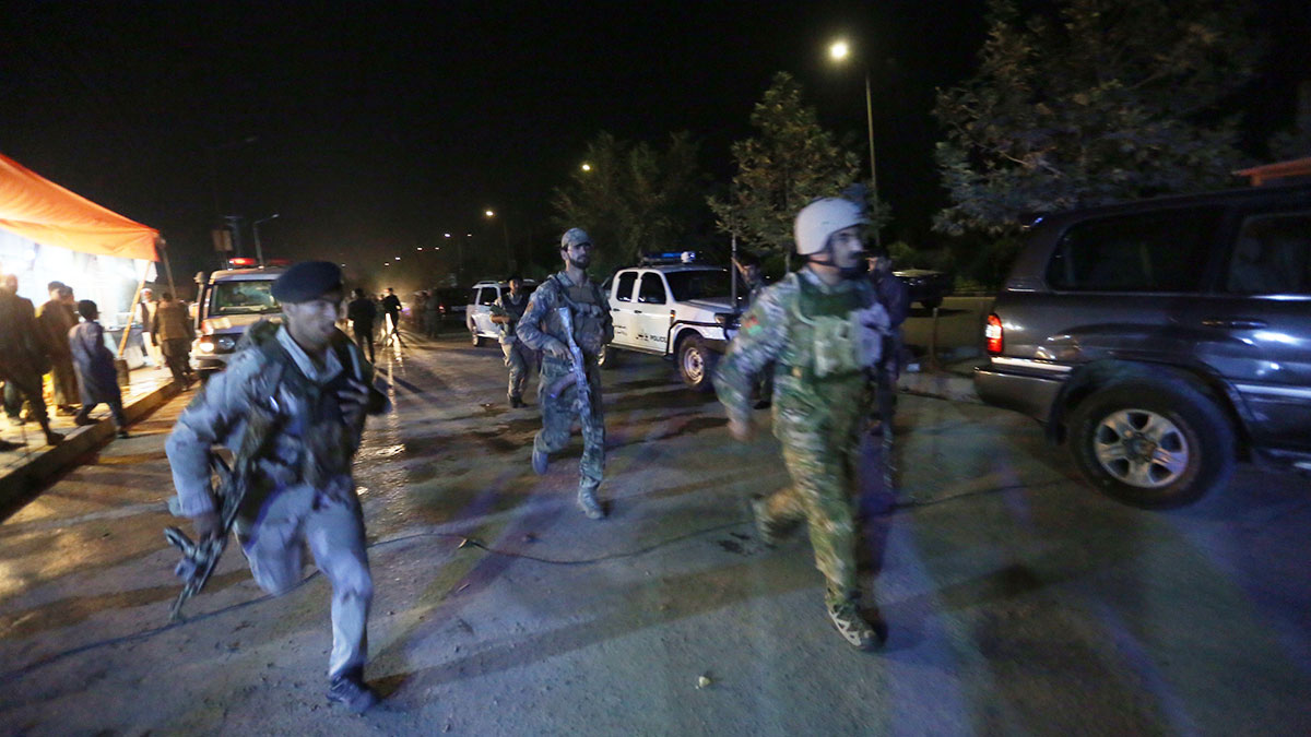 Afghan security forces rush to respond to a complex Taliban attack on the campus of the American University in Kabul on Aug. 24, 2016.