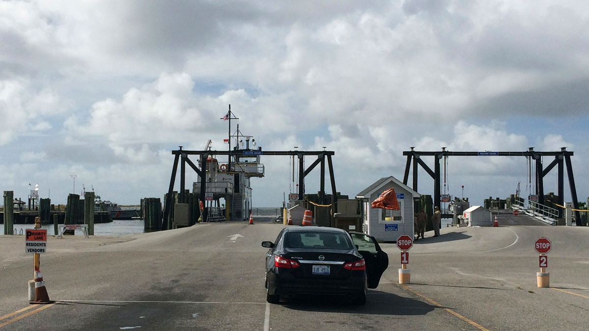 A lone car waits to be loaded on a ferry to Ocracoke Island in Hatteras, North Carolina, Aug. 30, 2016. A tropical weather system off the coast of North Carolina's Outer Banks is expected to strengthen in the next day, bringing winds up to 45 mph and heavy rains that could flood low-lying areas.