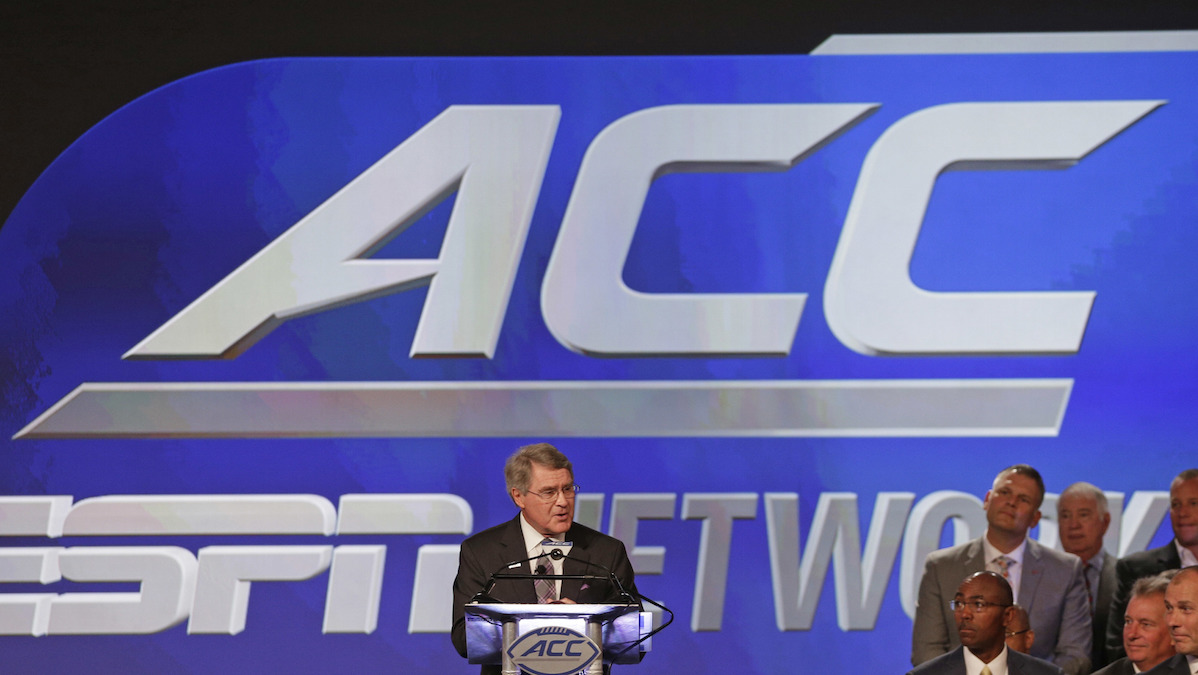 FILE - In this July 21, 2016, file photo, ACC Commissioner John Swofford, center, announces an ACC/ESPN Network during a news conference at the Atlantic Coast Conference Football Kickoff in Charlotte, N.C. The ACC follows NCAA lead and pulls athletic championships out of North Carolina amid backlash over bathroom law.