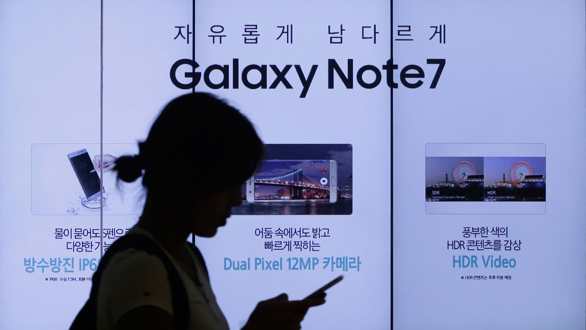 In a file photo from Sept. 2, 2016, a woman walks by an advertisement of Samsung Electronics Galaxy Note 7 smartphone at the company's showroom in Seoul, South Korea.
