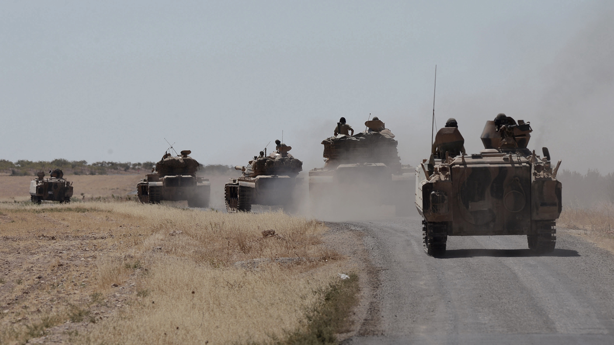 In this photo taken on Friday, Sept. 2, 2016, Turkish tanks head to the Syrian border, in Karkamis, Turkey. Turkey-backed Syrian rebels pushed ISIS from the symbolic village of Dabiq Oct. 16.