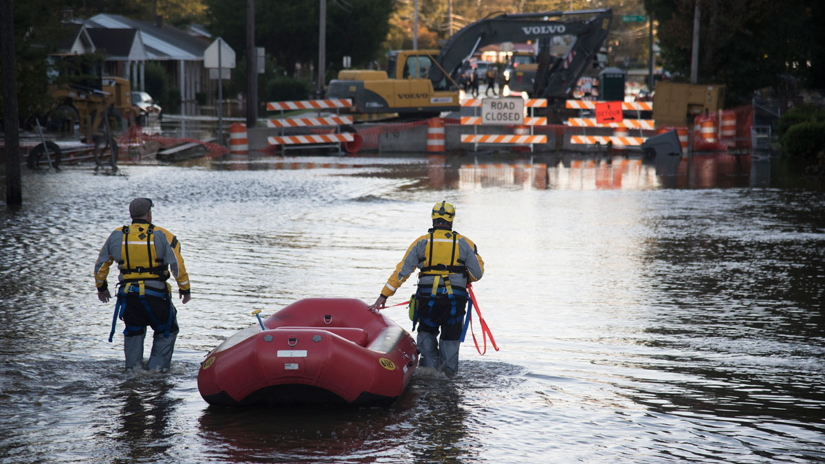 A swift water rescue team down a street covered by floodwaters caused by rain from Hurricane Matthew in Lumberton, North Carolina, Monday, Oct. 10, 2016.