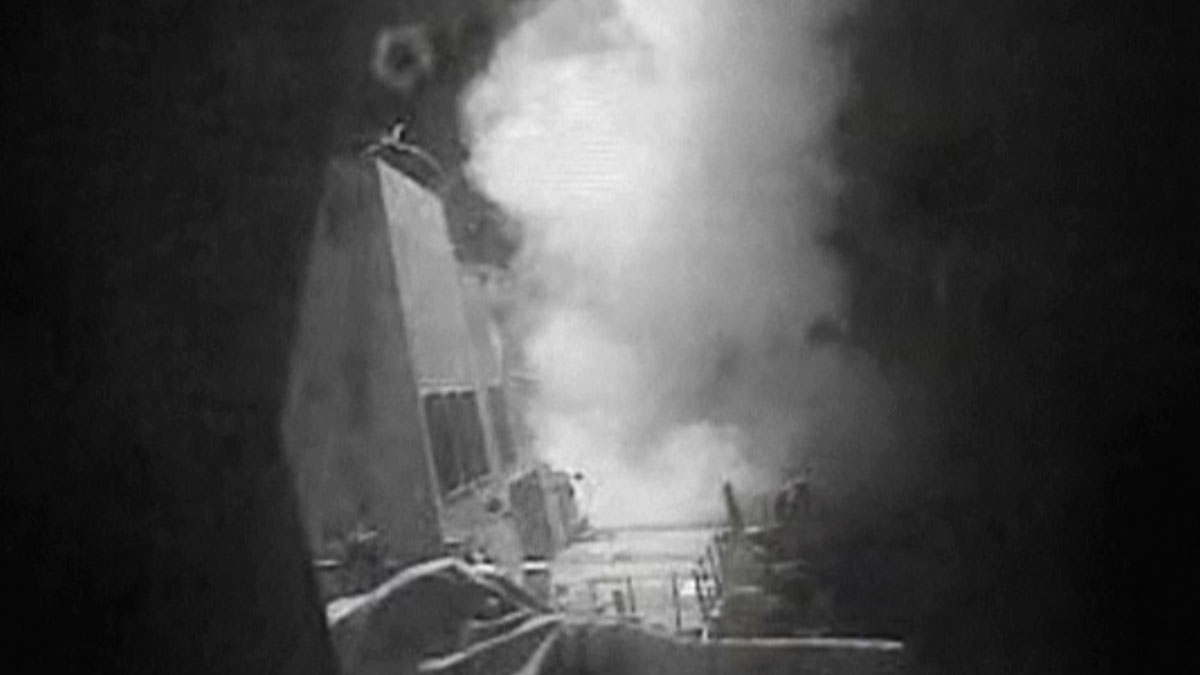 This frame grab of video provided by the United States Navy shows moments after a U.S.-launched Tomahawk cruise missile hits a coastal radar site in Houthi-controlled territory on Yemen's Red Sea Coast on Thursday, Oct. 13, 2016.