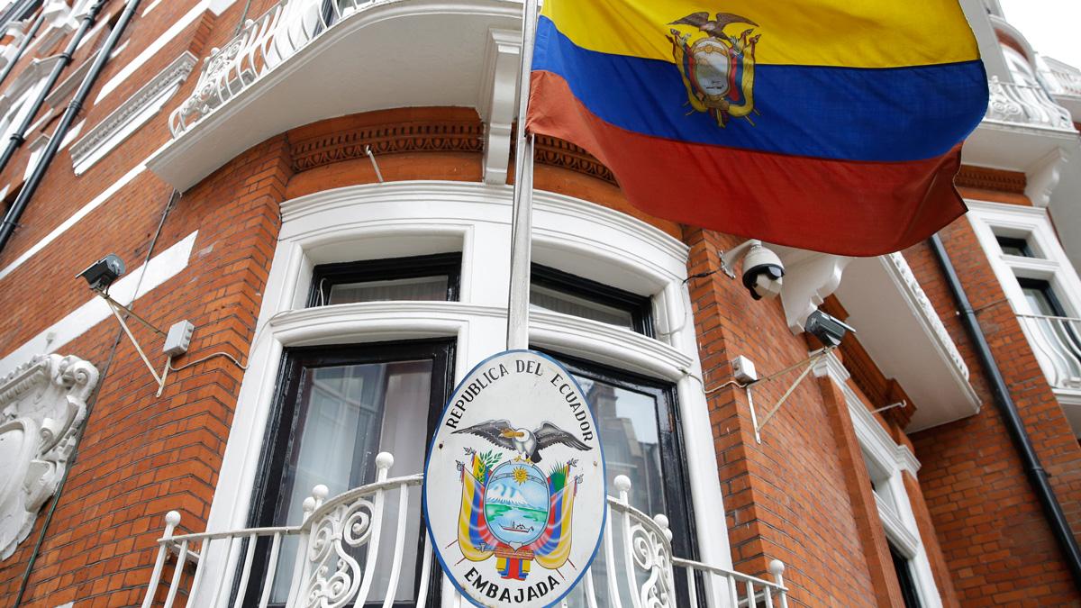 The Ecuadorian national flag flies outside their London Embassy, Tuesday, Oct. 18, 2016. Comedian Bobby Mair has been standing outside the embassy reading the news to Julian Assange through a bullhorn since the WikiLeaks founder's internet access was cut off.
