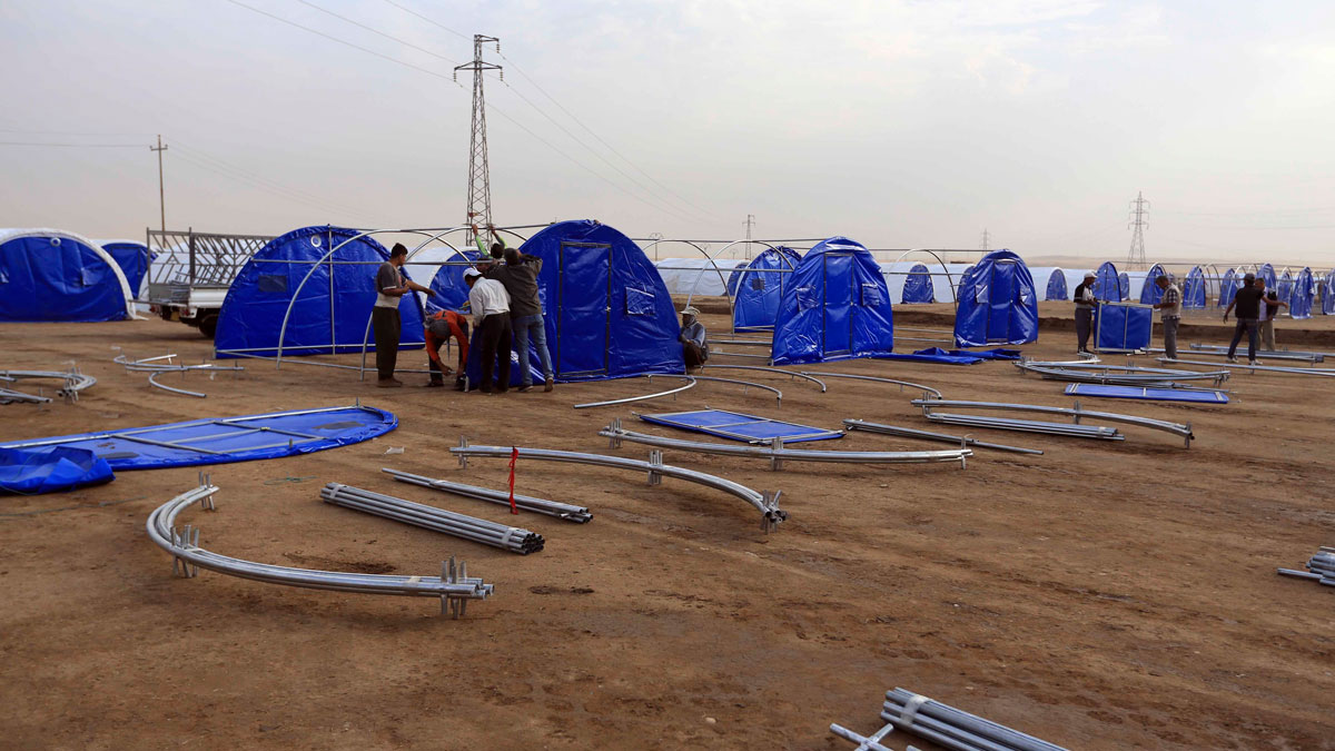 Workers set up a camp for displaced Iraqis in Khazer, Iraq, Wednesday, Oct. 19, 2016. More than 25,000 troops have mobilized for the Mosul fight, a massive operation that's expected to take weeks, if not months. Mosul is Iraq's second largest city and the largest urban area controlled by the Islamic State militants.
