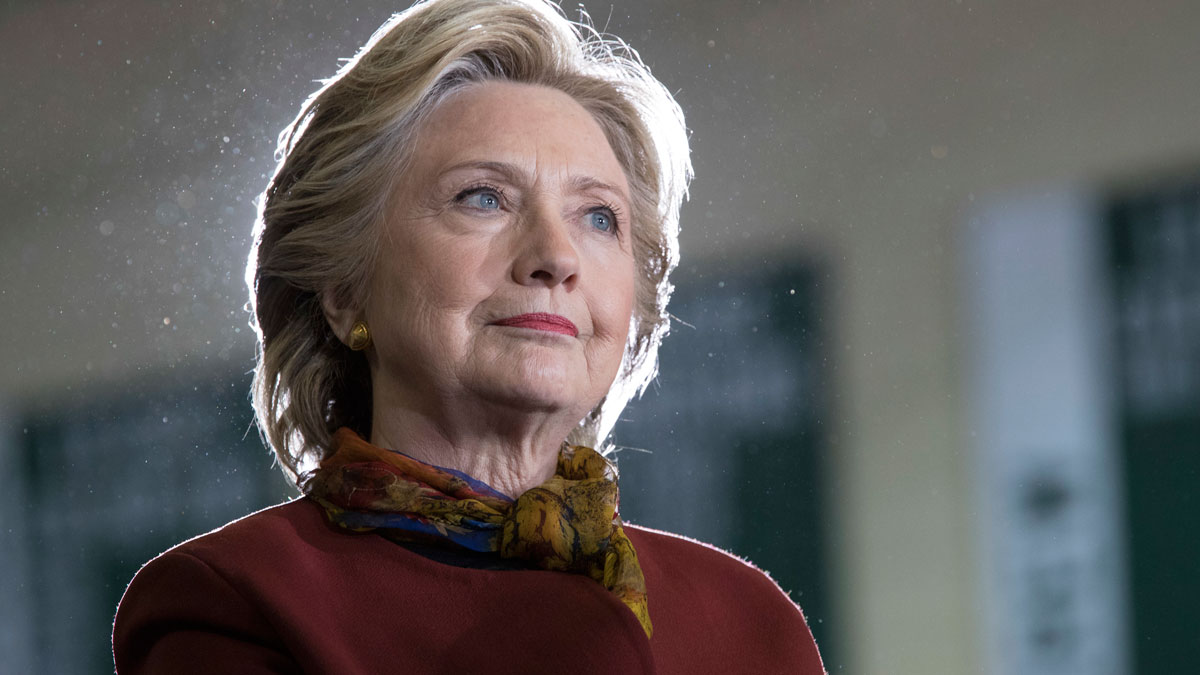 Democratic presidential candidate Hillary Clinton listens as vice presidential candidate Sen. Tim Kaine, D-Va. speaks during a campaign event at the Taylor Allderdice High School, Saturday, Oct. 22, 2016, in Pittsburgh, Pennsylvania.