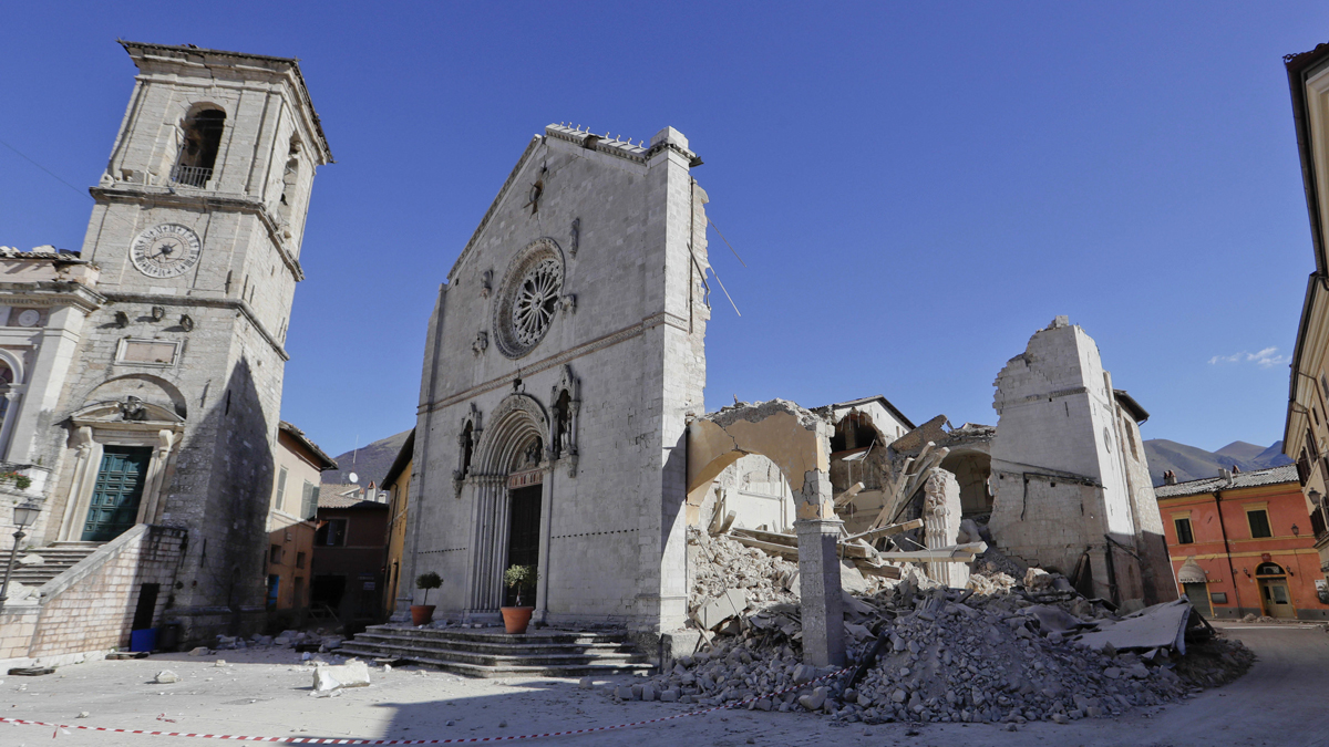 A view of the collapsed Cathedral of St. Benedict in Norcia, central Italy, Monday, Oct. 31, 2016. The third powerful earthquake to hit Italy in two months spared human life Sunday but struck at the nation's identity, destroying a Benedictine cathedral, a medieval tower and other beloved landmarks that had survived the earlier jolts across a mountainous region of small historic towns. (AP Photo/Gregorio Borgia)