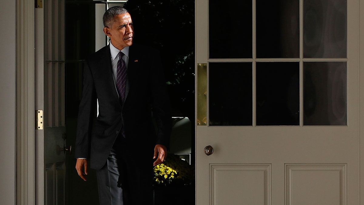President Barack Obama walks out of the main residence of the White House and down the Colonnade and heads towards the Oval Office, Tuesday, Nov. 8, 2016, in Washington.