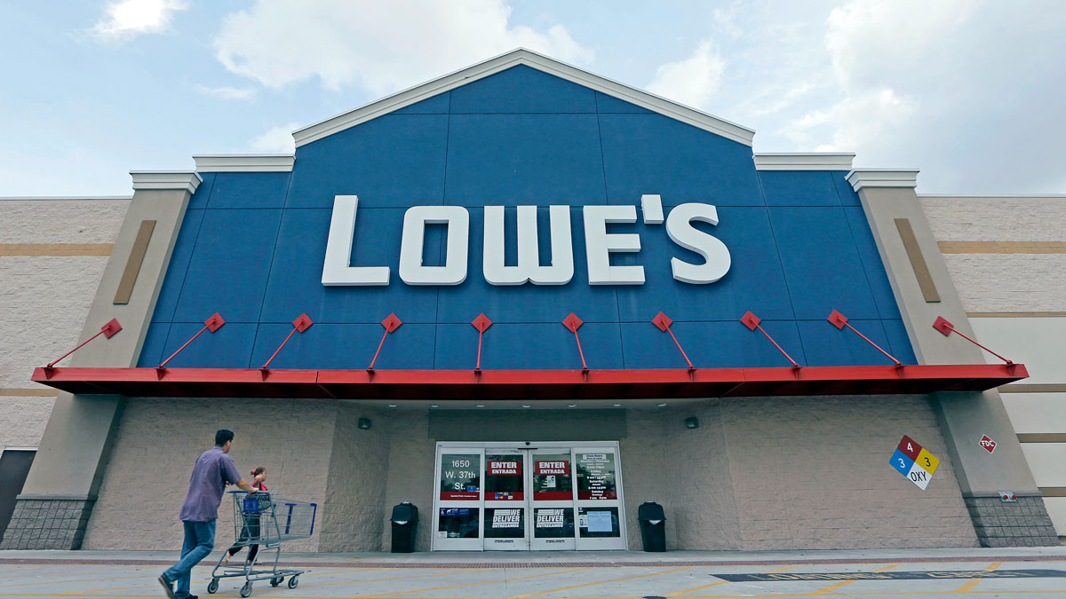FILE - In this June 29, 2016, file photo, customers walk toward a Lowe's store in Hialeah, Fla. Lowe's reports financial results Wednesday, Nov. 16. (AP Photo/Alan Diaz, File)
