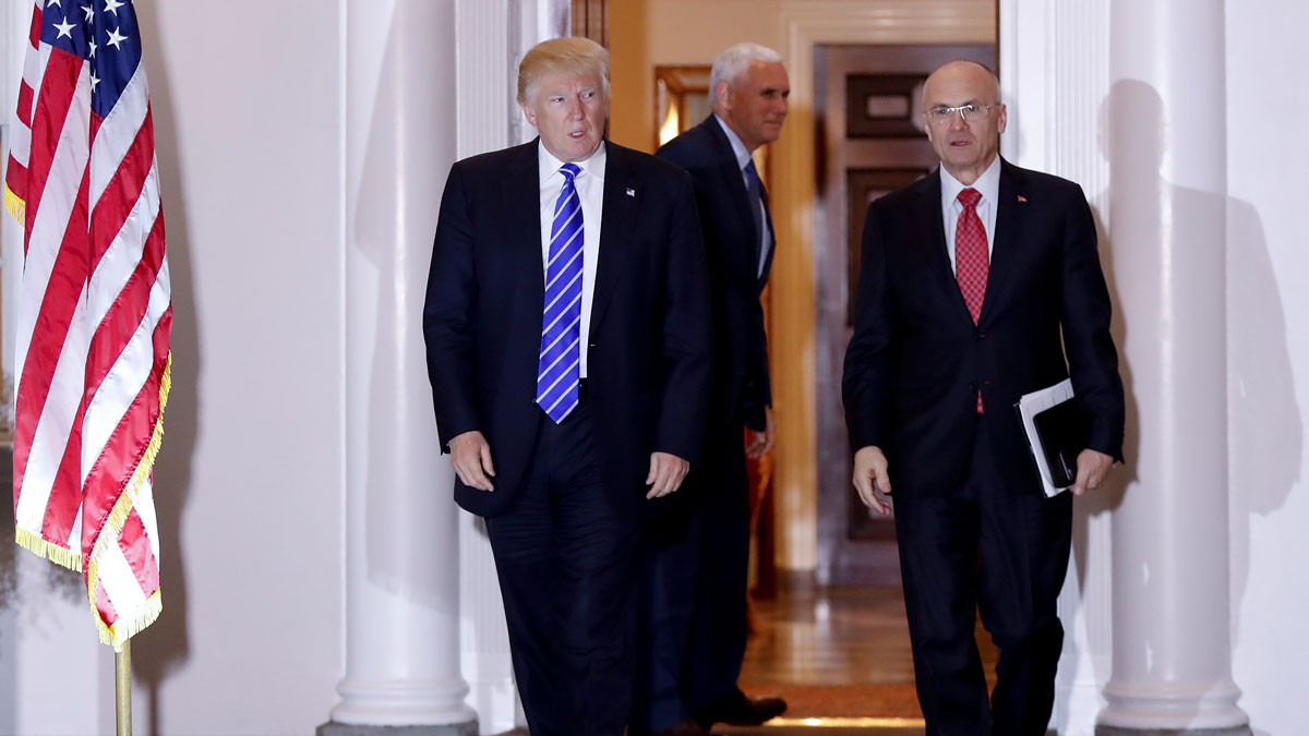 File photo: President-elect Donald Trump and Andy Puzder, chief executive of CKE Restaurants, walk from Trump National Golf Club Bedminster clubhouse in Bedminster, N.J., Saturday, Nov. 19, 2016. In the background is Vice President-elect Mike Pence.
