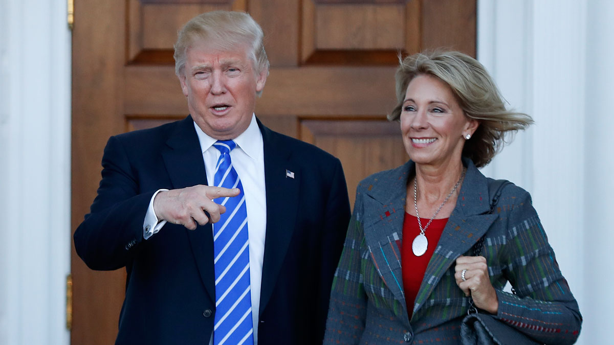 FILE - In this Nov. 19, 2016 file photo, President-elect Donald Trump and Betsy DeVos pose for photographs at Trump National Golf Club Bedminster clubhouse in Bedminster, N.J. Two GOP senators announced Wednesday that they would vote against her nomination for Secretary of Education.