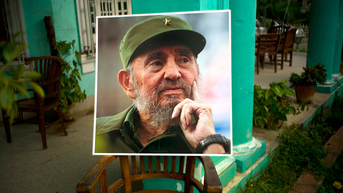 An image of the late Fidel Castro stands on a chair in a government building in Havana, Cuba, Sunday, Nov. 27, 2016. Cuba is observing nine days of mourning for the former president who ruled Cuba for half a century.