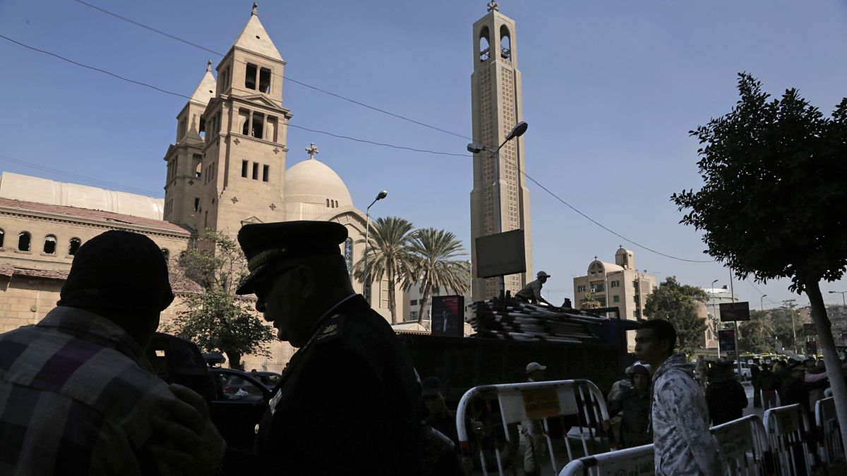 This Dec. 11, 2016, file photo shows Egyptian security forces standing guard outside St. Mark Cathedral in central Cairo, Egypt's main Coptic Christian cathedral. Officials said Friday at least 24 people were killed and 27 wounded in an attack by gunmen on a bus carrying Coptic Christians south of Cairo.