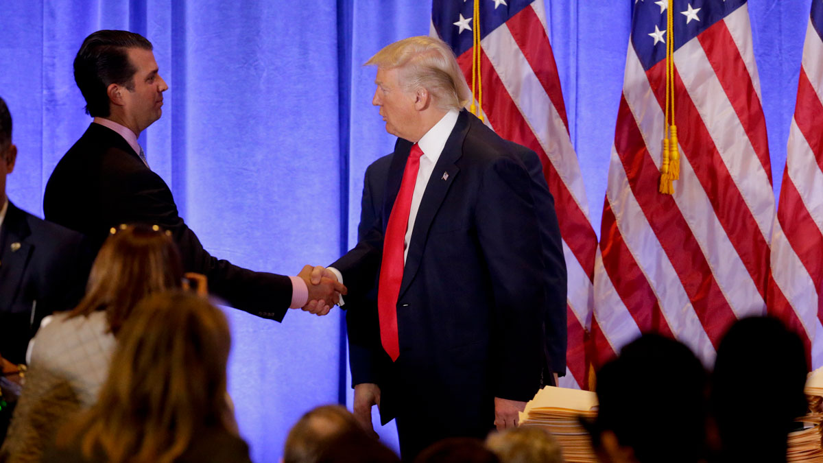 President-elect Donald Trump shakes hands with his son Donald Trump Jr. after speaking during a news conference, Wednesday, Jan. 11, 2017, in New York. The news conference was his first as President-elect.