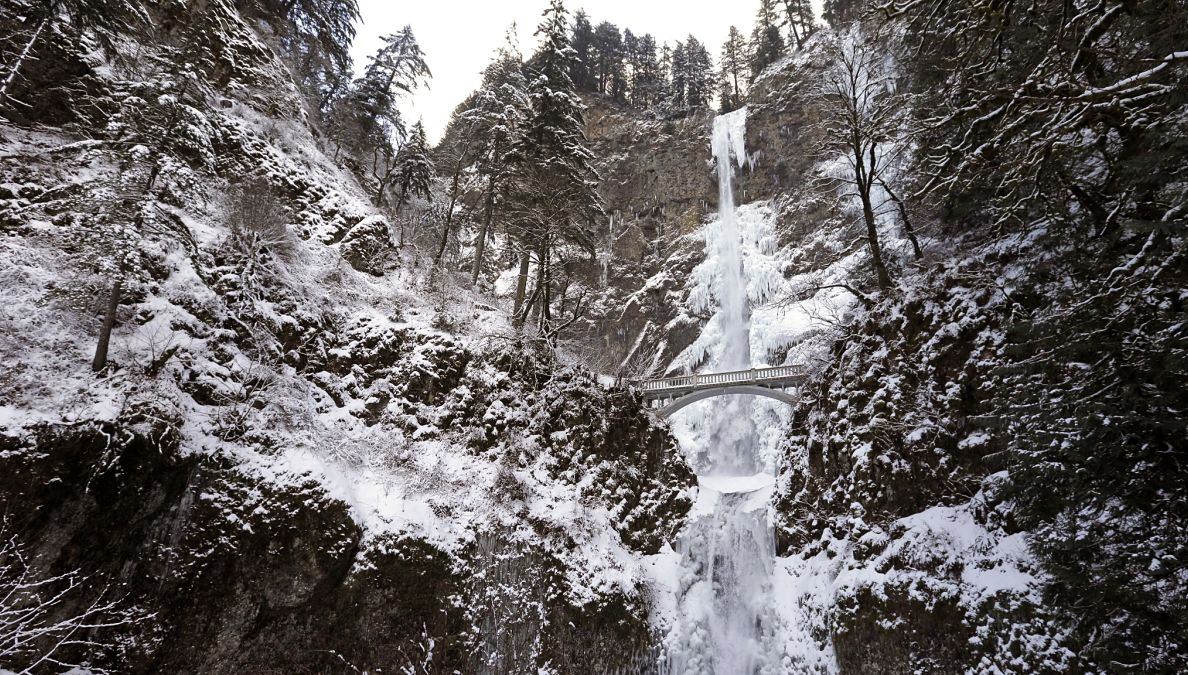 Snow and ice coats the cliff walls and ground surrounding Multnomah Falls in the Columbia River Gorge east off Portland, Ore., Friday, Jan. 13, 2017.