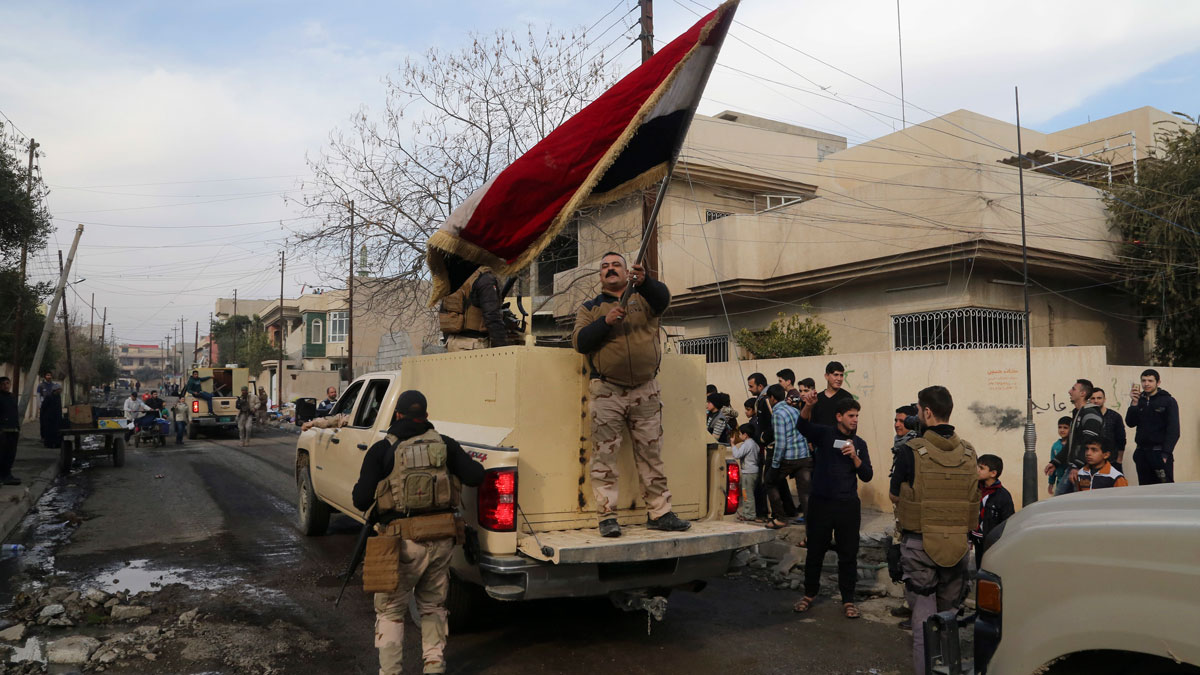 Iraqi security forces patrol in the eastern side of Mosul, Iraq, Wednesday, Jan. 18, 2017. U.S.-backed Iraqi government troops announced on Wednesday they were in