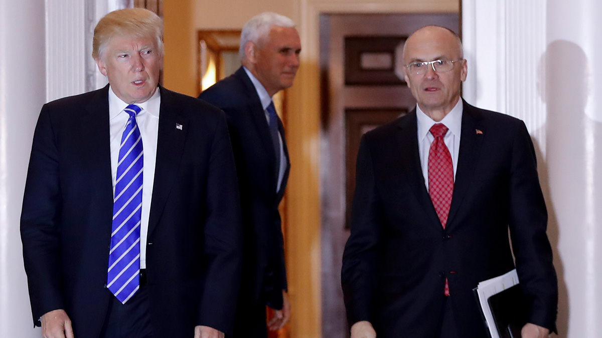 FILE - In this Nov. 19, 2016 file photo, President-elect Donald Trump walks Labor Secretary-designate Andy Puzder from Trump National Golf Club Bedminster clubhouse in Bedminster, New Jersey.