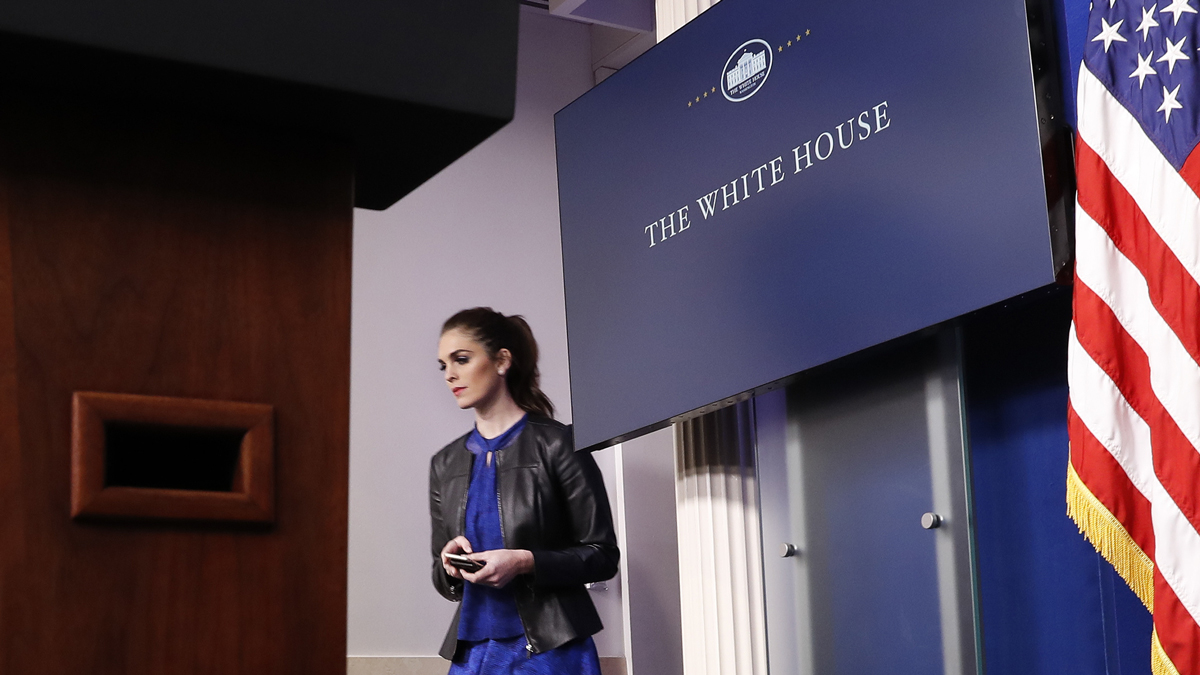 This Feb. 14, 2017, file photo shows Hope Hicks, adviser to President Donald Trump, walk to her seat before the start of the daily briefing in the Brady Press Briefing Room of the White House in Washington.