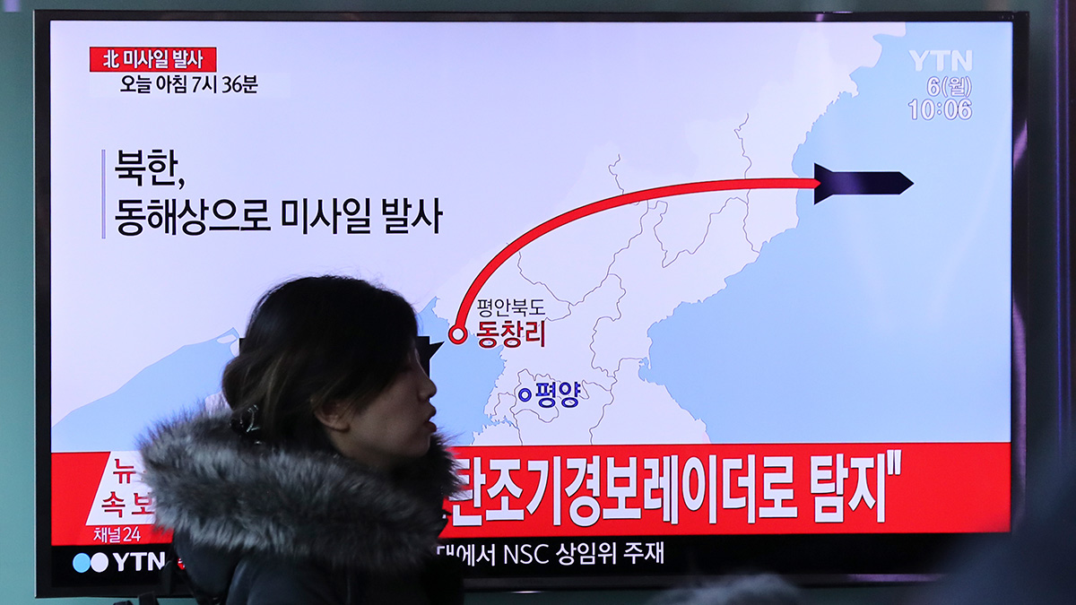 A visitor walks by the TV screen showing a news program reporting about North Korea's missile firing, at Seoul Train Station in Seoul, South Korea, Monday, March 6, 2017.